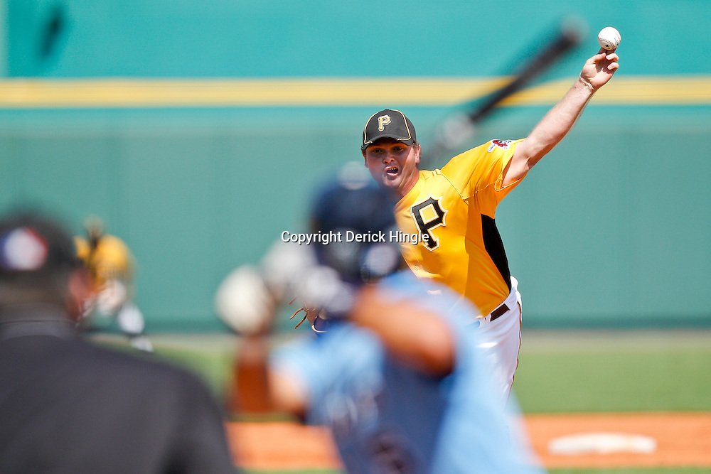February 25, 2011; Bradenton, FL, USA; Pittsburgh Pirates pitcher Justin Wilson (74) pitches during a spring training exhibition game against the State College of Florida Manatees at McKechnie Field. The Pirates defeated the Manatees 21-1. Mandatory Credit: Derick E. Hingle