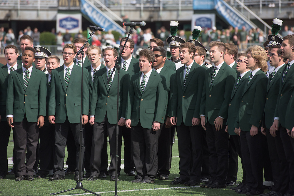 The Singing Men of Ohio perform the Star-Spangled Banner to start the Bobcats homecoming matchup against Bowling Green at Peden Stadium in Athens, Ohio on Saturday, October 8, 2016.