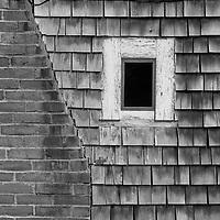 A brick chimney with a window
