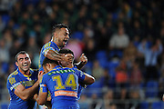 GOLD COAST, AUSTRALIA - JULY 26:  Corey Norman (obscured) of the Eels celebrates scoring a try with team mates during the round 20 NRL match between the Gold Coast Titans and the Parramatta Eels at Cbus Super Stadium on July 26, 2014 on the Gold Coast, Australia.  (Photo by Matt Roberts/Getty Images)
