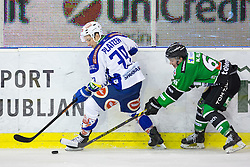 16.01.2015, Hala Tivoli, Ljubljana, SLO, EBEL, HDD Telemach Olimpija Ljubljana vs EC VSV, 39. Runde, in picture Patrick Platzer (EC VSV, 39) and Luka Kalan (HDD Telemach Olimpija, #61) during the Erste Bank Icehockey League 39. Round between HDD Telemach Olimpija Ljubljana and EC VSV at the Hala Tivoli, Ljubljana, Slovenia on 2015/01/16. Photo by Morgan Kristan / Sportida