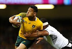 Australia Full Back Israel Folau bursts past Fiji Hooker Talemaitoga Taupati  - Mandatory byline: Joe Meredith/JMP - 07966386802 - 23/09/2015 - Rugby Union, World Cup - Millenium Stadium -Cardiff,Wales - Australia v Fiji - Rugby World Cup 2015 - Pool A