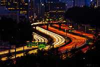 Twilight view of traffic on Interstate 5 with Downtown Seattle behind, Washington State USA.