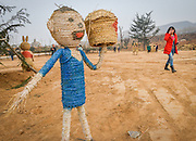 LUOYANG, CHINA - MARCH 16: (CHINA OUT) <br /> <br /> A strawman is seen at a construction site on March 16, 2016 in Luoyang, Henan Province of China. Various straw dolls like dinosaurs, ducks, Minions, elephants, pandas and small trains as well we others are made at a construction site which attracted citizens and visitors. <br /> ©Exclusivepix Media