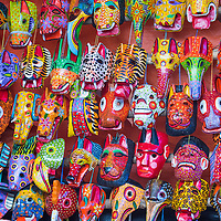 Mayan wooden masks for sale at Chichicastenango market in Guatemala.