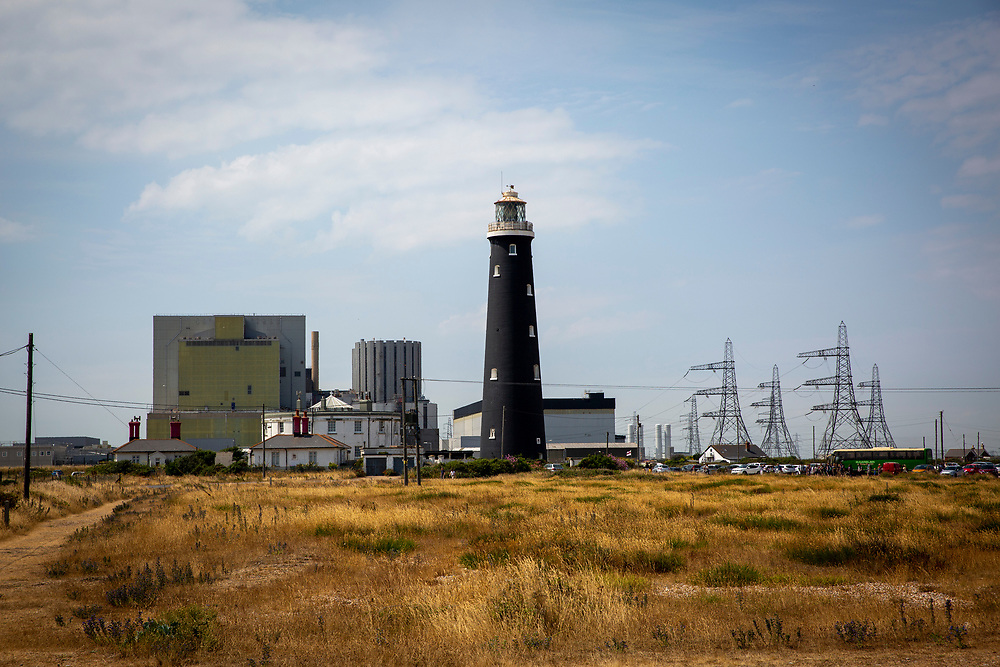 The Old Lighthouse of Dungeness, Kent, United Kingdom. A Historic Grade II listed building, it is the fourth lighthouse built on Dungeness and was built in 1904. Behind the lighthouse is Dungeness Nuclear Power Station.  This is a twin reactor plant located on the headlands overlooking a nature reserve and Site of Special Scientific Interest. (photo by Andrew Aitchison / In pictures via Getty Images)