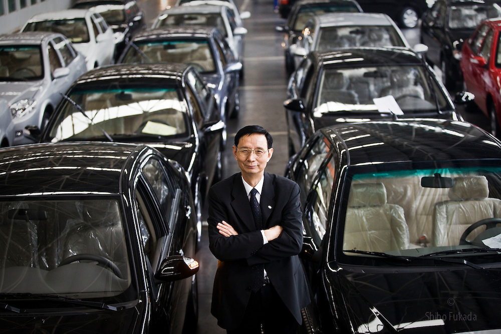"""Yin Ming Shan, the """"motorcycle king"""", President of Lifan Industry, poses for a portrait at his car factory in Chongqing, China, March 4, 2009."""