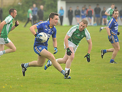 Hollymount-Carramore's Ian Costello tries to get past Burrischoole's David Keane during the Intermediate championship match on saturday evening last.<br /> Pic Conor McKeown