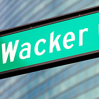 Wacker Drive street sign in Chicago. Wacker Drive is one of Chicago's most well known streets and travels through the heart of downtown Chicago.