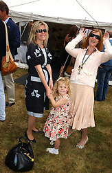 "Left to right, LADY LINLEY, her daughter the HON.MARGARITA ARMSTRONG-JONES and LADY STEWART wife of Jackie Stewart at the Goodwood Festival of Speed on 9th July 2006.  Cartier sponsored the ""Style Et Luxe' for vintage cars on the final day of this annual event at Goodwood House, West Sussex and hosted a lunch.<br />