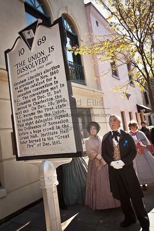 CHARLESTON, SC - DECEMBER 20: Historic re-enactors dressed in period costume stop to view the newly unveiled marker December 20, 2010 in observance of the 150th Anniversary of South Carolina's Secession from the Union in Charleston, SC. South Carolina was the first state to secede resulting in the US Civil War.  (Photo by Richard Ellis/Getty Images)