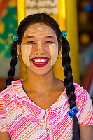 Burmese woman wearing thanaka bark, makeup, Bago, Myanmar (Burma)