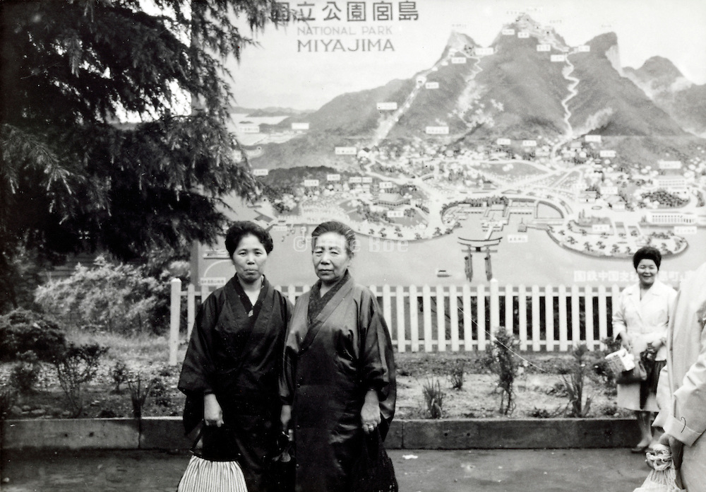 early Japanese domestic tourism posing at a billboard view of Miyajima 1960s