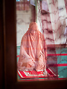 10 JULY 2015 - BANGKOK, THAILAND: A woman prays in the women's prayer room  before Iftar at Haroon Mosque in Bangkok. Iftar is the evening meal when Muslims end their daily Ramadan fast at sunset. Iftar is a communal event at Haroon Mosque and hundreds of people usually attend the meal.     PHOTO BY JACK KURTZ