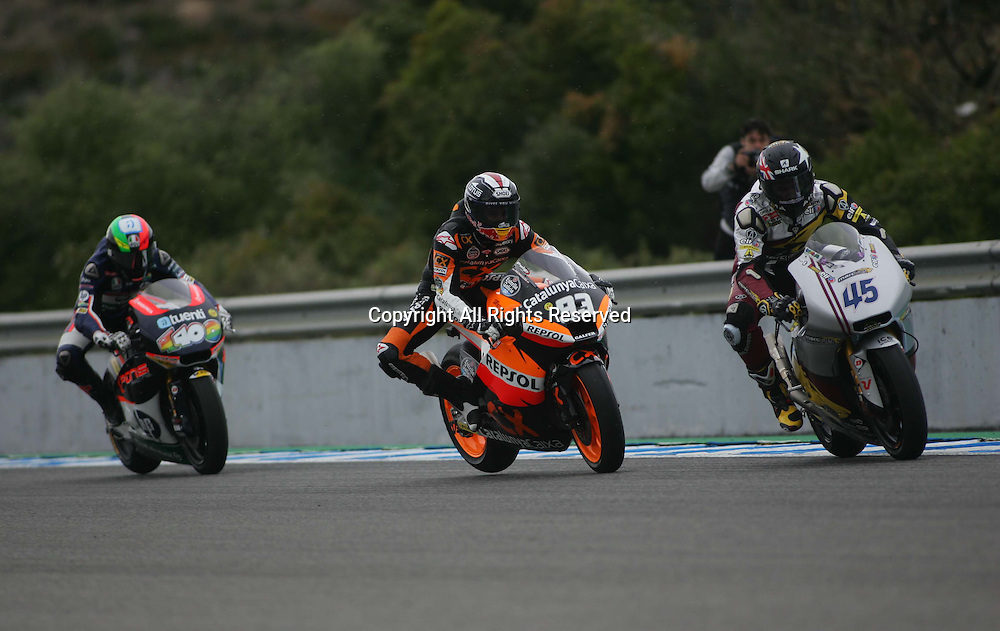 29.04.2012. Jerez, Spain. Frand Prix of Spain BWIN Race 2. Picture shows Pol Espargaro riding Kalex (ESP) Marc Marquez (ESP) riding Suter and Scott Redding riding Kalex (GBR)