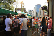 People celebrating the annual American Beer Festival over the 4th July weekend at the White Horse in Parsons Green, London SW6.