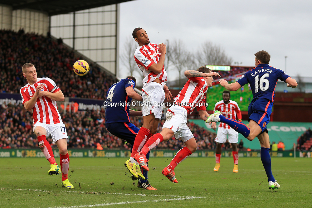 1st January 2015 - Barclays Premier League - Stoke City v Manchester United - Stoke defenders Ryan Shawcross (L) and Steven N'Zonzi (C) see the ball fly across the area - Photo: Simon Stacpoole / Offside.