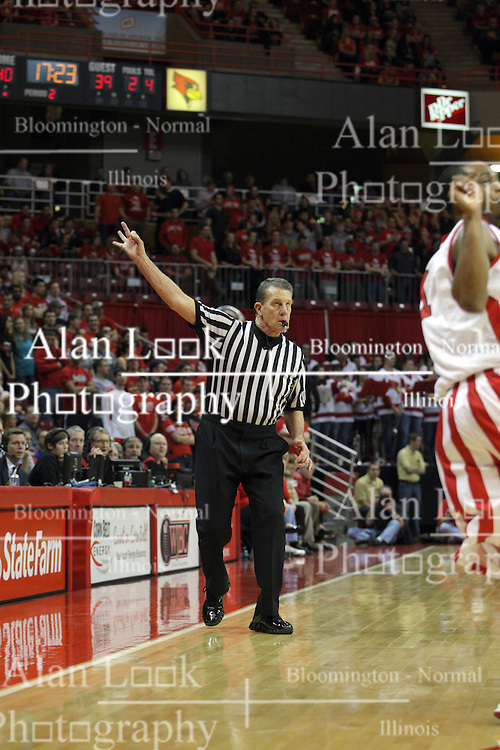 13 February 2013:  referee Rick Hartzell hold up 3 fingers to signify the shot taken was beyond the 3 point shot line during an NCAA Missouri Valley Conference mens basketball game where the Bradley Braves were defeated by Illinois State Redbirds 79-59 in Redbird Arena, Normal IL