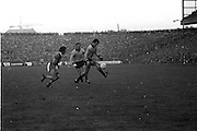 Dublin bounces the ball on his foot while running from Kerry during the All Ireland Senior Gaelic Football Final, Kerry v Dublin in Croke Park on the 28th September 1975. Kerry 2-12 Dublin 0-11.