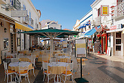 LAGOS, PORTUGAL - JUNE 22, 2006: View to the pedestrian street with restaurants in Lagos, Portugal.