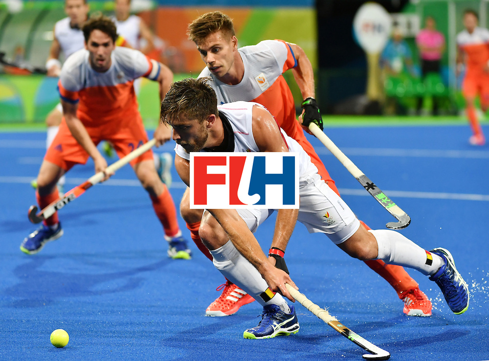 Belgium's Cedric Charlier (L) vies with Netherland's Sander de Wijin during the men's semifinal field hockey Belgium vs Netherlands match of the Rio 2016 Olympics Games at the Olympic Hockey Centre in Rio de Janeiro on August 16, 2016. / AFP / Pascal GUYOT        (Photo credit should read PASCAL GUYOT/AFP/Getty Images)