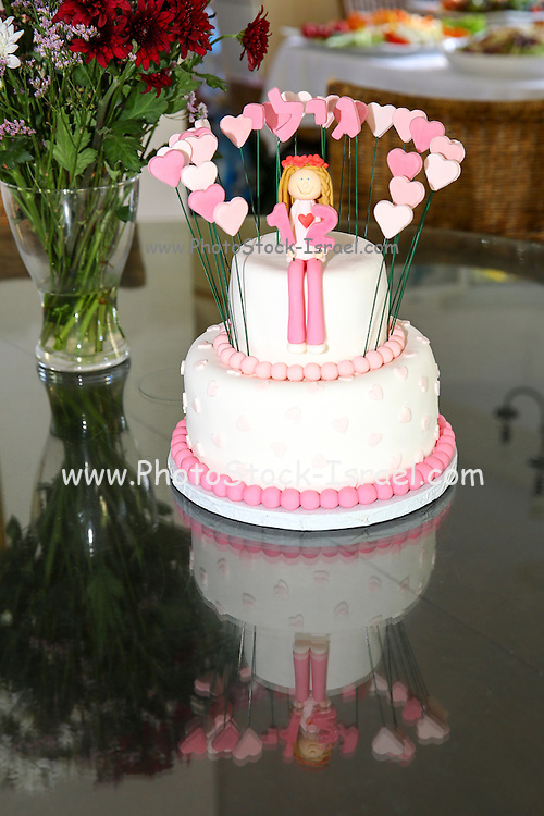 A buffet of pink cake