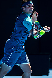 January 21, 2019 - Melbourne, VIC, U.S. - MELBOURNE, AUSTRALIA - JANUARY 21 : Milos Raonic of ÊCanada returns the ball during day 8 of the Australian Open on January 21 2019, at Melbourne Park in Melbourne, Australia.(Photo by Jason Heidrich/Icon Sportswire) (Credit Image: © Jason Heidrich/Icon SMI via ZUMA Press)