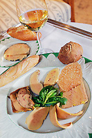 "July 2002, Boulogne-Billancourt, France --- Original caption: A presentation of a variety of foie gras at Restaurant Comte de Gascogne, specializing in foods of the southwest of France. The curly ones are carpaccio (raw foie gras); then a terrine (with crispy ""tuille"" standing up); cooked in sauternes; cooked in madiran (a red wine from the southwest); almonds and honey; the behind and to the left; peppered. --- Image by © Owen Franken"