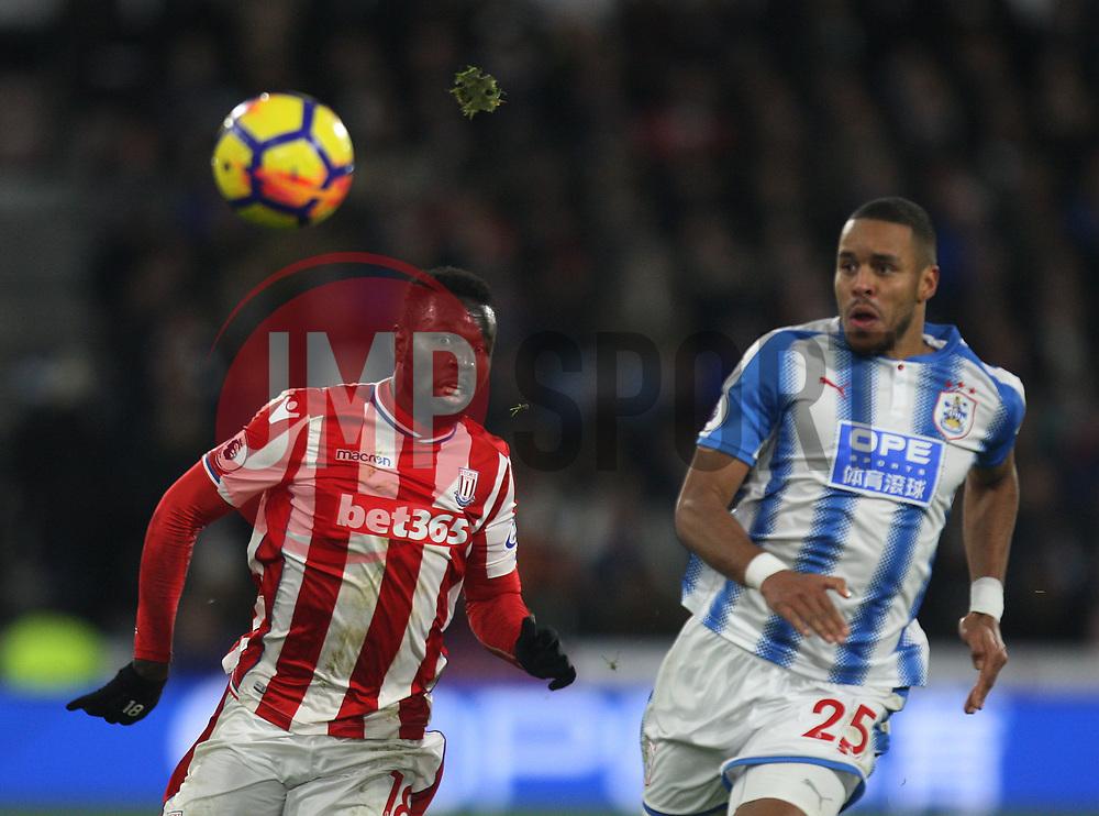 Mame Biram Diouf of Stoke City (L) in action - Mandatory by-line: Jack Phillips/JMP - 26/12/2017 - FOOTBALL - The John Smith's Stadium - Huddersfield, England - Huddersfield Town v Stoke City - English Premier League