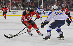 Feb 9; Newark, NJ, USA; New Jersey Devils right wing David Clarkson (23) skates with the puck while being defended by St. Louis Blues defenseman Kevin Shattenkirk (22) during the second period at the Prudential Center.