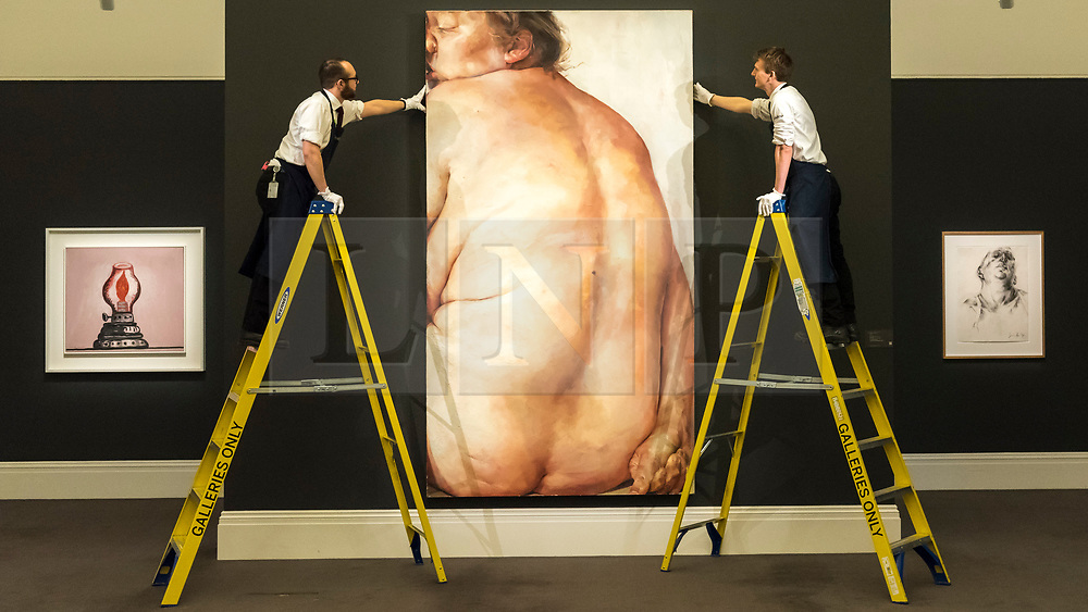 © Licensed to London News Pictures. 01/03/2019. LONDON, UK. Technicians hang ''Juncture'', 1994, by Jenny Saville, (Est. £5,000,000 - 7,000,000). Preview of Sotheby's Contemporary Art Sale in their New Bond Street galleries.  Works by artists including Tracey Emin, Jenny Saville, Jean-Michel Basquiat and Andy Warhol will be offered for auction on 5 March 2019.  Photo credit: Stephen Chung/LNP