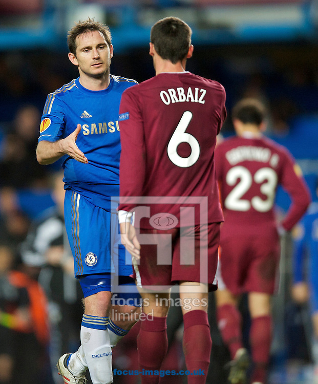 Picture by Alan Stanford/Focus Images Ltd +44 7915 056117.04/04/2013.Frank Lampard of Chelsea shakes hands with Pablo Orbais of Rubin Kazan at full time in the UEFA Europa League match at Stamford Bridge, London.
