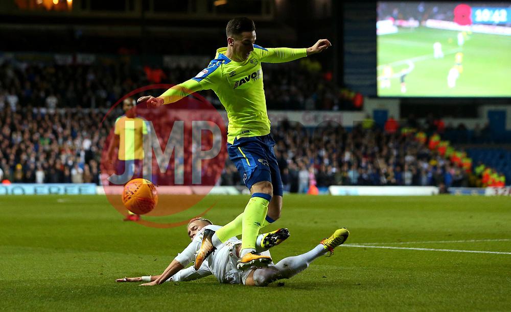 Tom Lawrence of Derby County is tackled by Ezgjan Alioski of Leeds United - Mandatory by-line: Robbie Stephenson/JMP - 31/10/2017 - FOOTBALL - Elland Road - Leeds, England - Leeds United v Derby County - Sky Bet Championship