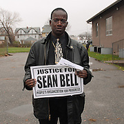 Mourner Stefan Johnson, 32, leaves the wake of Sean Bell, 23, (depicted on McPherson's jacket) who was killed in a hail of 50 bullets by New York City police officers, at the Community Church of Christ in Queens, New York on December 1, 2006. Bell was killed in the early morning of November 25, 2006 leaving his bachelor party at Club Kalua in Queens, just hours before he as scheduled to marry in the church where his funeral was held.<br />