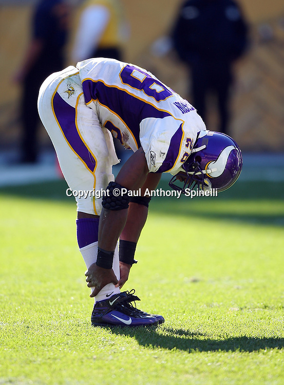 Minnesota Vikings running back Adrian Peterson (28) stretches during a break in the action at the NFL football game against the Pittsburgh Steelers, October 25, 2009 in Pittsburgh, Pennsylvania. The Steelers won the game 27-17. (©Paul Anthony Spinelli)