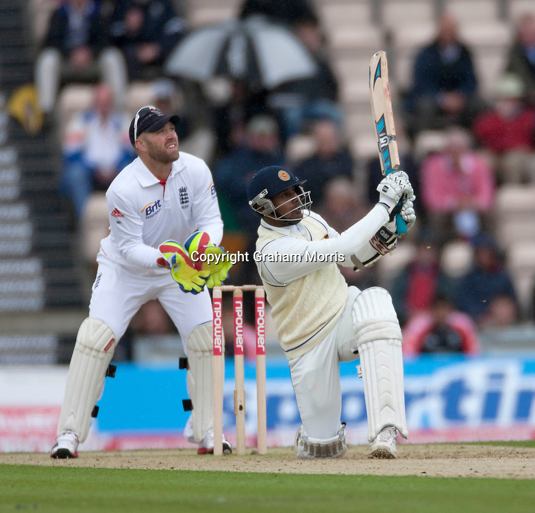 Prasanna Jayawardene (and wicket keeper Matt Prior) watches as he's caught by Eoin Morgan off Graeme Swann during the third npower Test Match between England and Sri Lanka at the Rose Bowl, Southampton.  Photo: Graham Morris (Tel: +44(0)20 8969 4192 Email: sales@cricketpix.com) 17/06/11