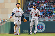 Miguel Cabrera #24 of the Detroit Tigers plays around next to teammate Jhonny Peralta #27 during a pitching change against the Minnesota Twins on June 15, 2013 at Target Field in Minneapolis, Minnesota.  The Twins defeated the Tigers 6 to 3.  Photo: Ben Krause