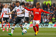 Derby County midfielder Bradley Johnson and Huddersfield forward Elias Kachunga battle for the ball during the EFL Sky Bet Championship match between Derby County and Huddersfield Town at the Pride Park, Derby, England on 17 April 2017. Photo by Aaron  Lupton.