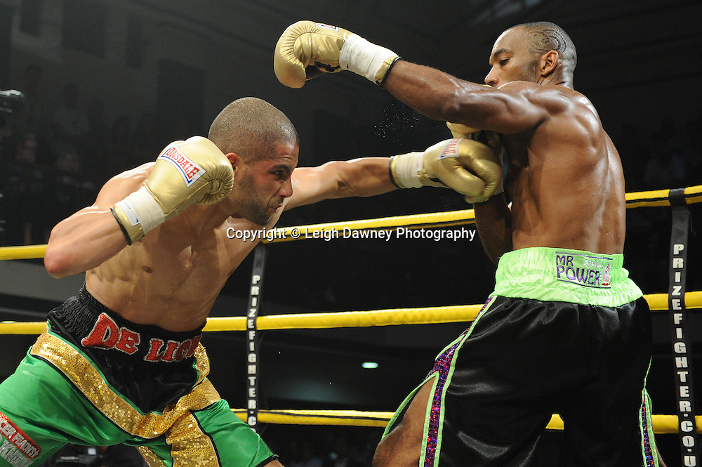 Junior Witter (green black shorts) defeats Nathan Graham at Quarter Final Two at Prizefighter Welterweights II,York Hall, Bethnal Green ,London. Matchroom Sport/Prizefighter.Photo credit: Leigh Dawney 2011 07.06.11