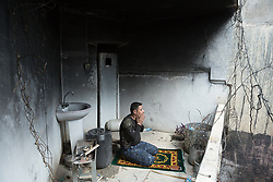 Licensed to London News Pictures. 02/04/2017. Mosul, Iraq. An Iraqi Federal Police officer prays in a recently liberated West Mosul home.<br /> <br /> Iraqi forces continue to fight house to house as they push further into West Mosul. Iraqi forces are now advancing on the city's old districts where Islamic State fighters still hold out. Photo credit: Matt Cetti-Roberts/LNP