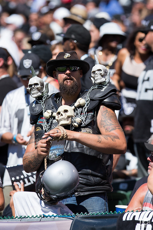 An Oakland Raiders fan dresses in a costume during a game against the Atlanta Falcons at Oakland Coliseum in Oakland, Calif., on September 18, 2016. (Stan Olszewski/Special to S.F. Examiner)