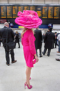 UNITED KINGDOM, London: 14 June 2016 A racegoer at Waterloo train station looks at train times before heading to Royal Ascot for the first day of the annual horse racing event. Rick Findler / Story Picture Agency
