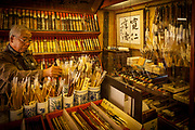 Japanese man chooses a calligraphy brush in traditional shop, Nara, Japan,