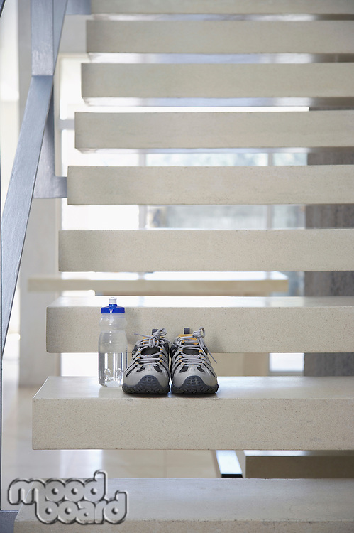 Sneakers and Water Bottle Left on the Stairway