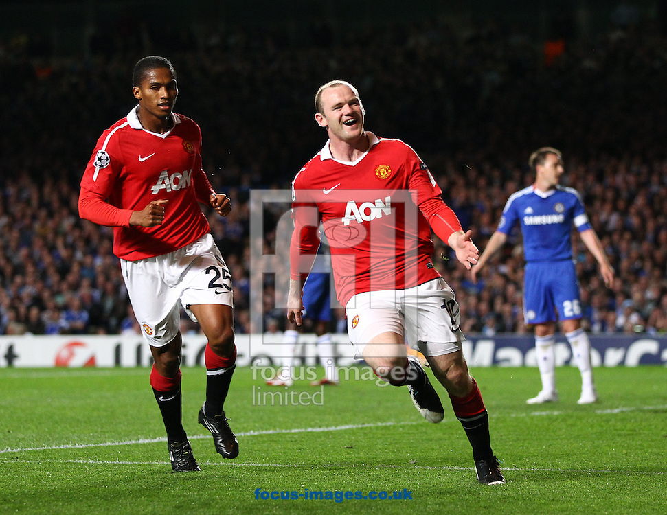 Wayne Rooney of Manchester United celebrates scoring the first goal during the Champions League quarter final 1st leg match between Chelsea and Manchester United at Stamford Bridge on Wednesday 6th April 2011. (Photo by Andrew Tobin/Focus Images)