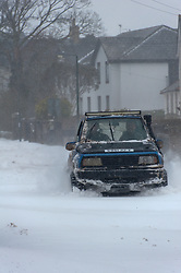 © Licensed to London News Pictures. 2/03/2018. Brynmawr, Blaenau Gwent,, South Wales, UK. Two young lads in a custom off-road vehicle have fun in the streets of Brynmawr. People battlle against the blizzard, snowdrifts and horrendous weather conditions as Storm Emma continues without mercy at Brynmawr in South Wales (the highest town in Wales.)  Photo credit: Graham M. Lawrence/LNP