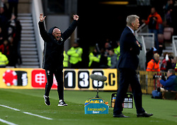 Middlesbrough manager Steve Agnew celebrates Marten de Roon of Middlesbrough scoring a goal as Sunderland manager David Moyes looks dejected - Mandatory by-line: Robbie Stephenson/JMP - 26/04/2017 - FOOTBALL - Riverside Stadium - Middlesbrough, England - Middlesbrough v Sunderland - Premier League