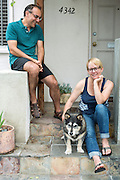 Jenny and Leo sit on their front stoop with their dog, Murphy, Marina del Rey, CA