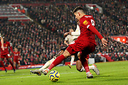 Liverpool forward Roberto Firmino (9) goes for the cut back during the Premier League match between Liverpool and Manchester United at Anfield, Liverpool, England on 19 January 2020.