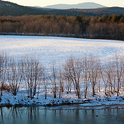 The view from a bluff overlooking the Merrimack River in Canterbury, New Hampshire. Winter. Corn field.